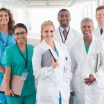 A diverse group of hospital doctors, surgeons, and nurses