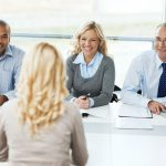 Female interviewing with three people