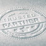 "embossed ""Trusted Partner"" stamp"