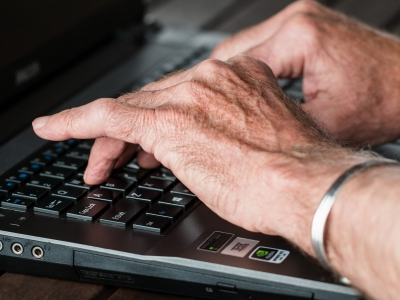 Elderly person using laptop
