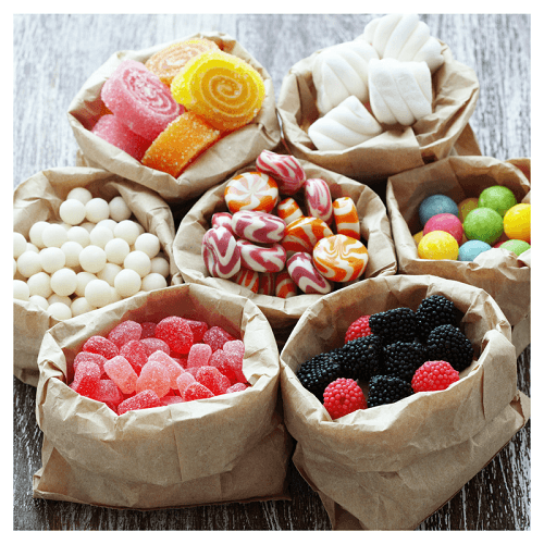 seven bags of different candies