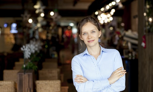 Portrait of a female restaurant manager crossing her arms