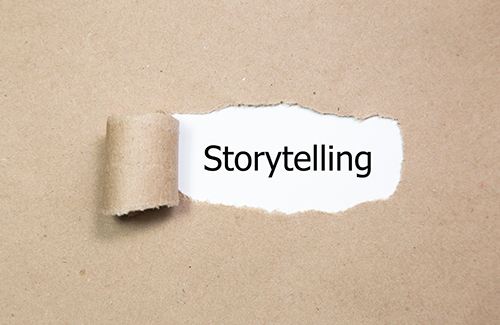 Ripped paper revealing the word storytelling