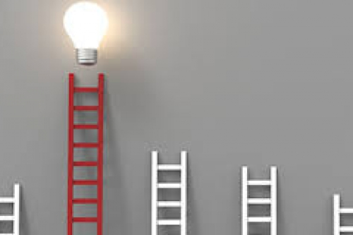 Four white ladders of different heights with a red ladder that has a light bulb above it