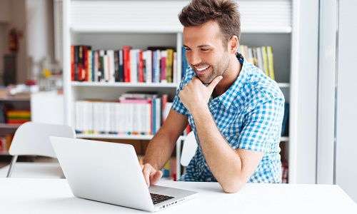 Candidate on a laptop taking a pre-employment assessment