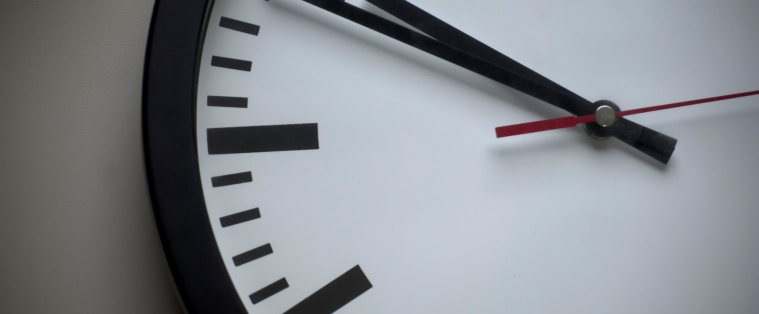 Close up image of analog clock showing time of 10:50