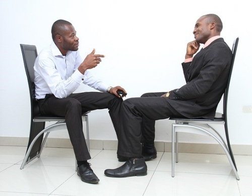 Two employees having a conversation